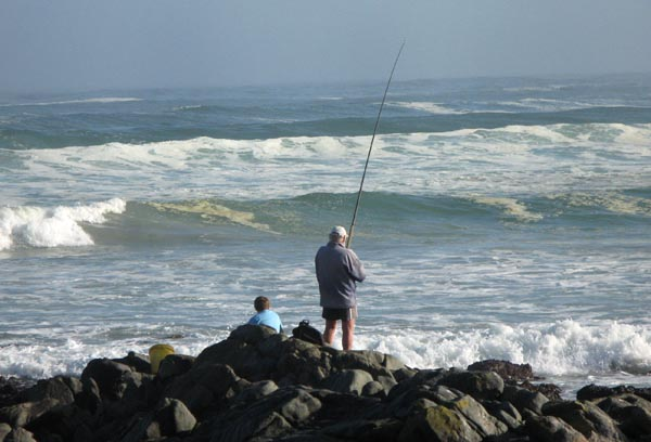 Father and son enjoying some rock fishing.