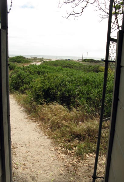 The security gate leading to the beach.