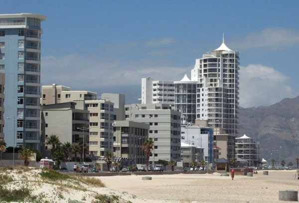 More modern buildings linning the beach road.